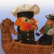Stock Photo: Souvenir. captain and doll in swimming by ship-duck