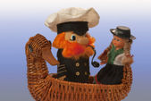 Souvenir. The captain and a doll in swimming by the ship-duck — Stock Photo