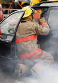 Fireman at the scene of a car accident. — Stock Photo