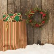 Stock Photo: Wreath and bag with Christmas gifts on snow.