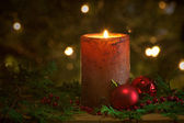 Christmas candle with sparkling lights. — Stok fotoğraf