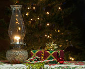 Christmas gift with lit oil lamp. — Stock Photo