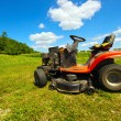 Stock Photo: Wide angle old riding mower.