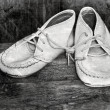 Stock Photo: Vintage style image with desaturated baby shoes.