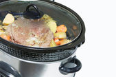 Close up slow cooker with roast beef and vegetables. — Stock Photo