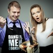 Stock Photo: Danger, men cooking