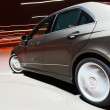 Side view of a car driving fast — Stock Photo