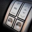 Car audio control buttons - Stock Photo