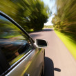 Car driving fast — Stock Photo