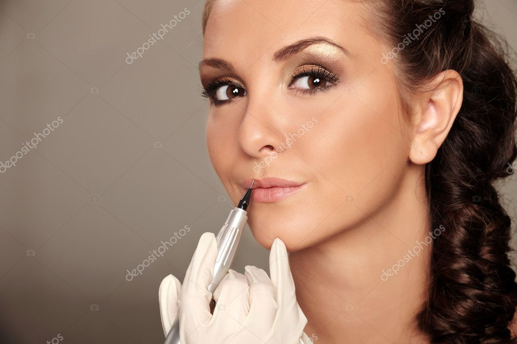 Professional permanent makeup applying  Stock Photo #7463932
