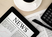 Tablet PC With News On Desk — Stock Photo