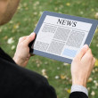 Reading News On Tablet PC — Stock Photo #7591913