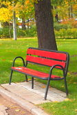 Bench in a holiday park in autumn — Stock Photo