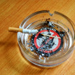 Ashtray with a cigarette butt — Stock Photo