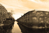 View of the old canal in Kronstadt, sepia. — Stock Photo