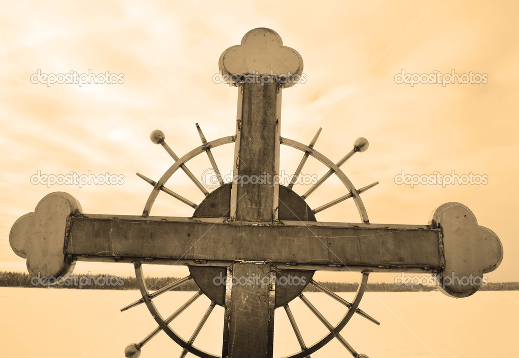 Metal cross on sky background. Sepia .  Stock Photo #7082287