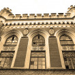 Old building in the Gothic Revival style. Sepia. — Stock Photo