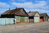 Rural street with abandoned houses — Stock Photo