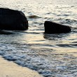 Water and rocks at sunset - Stockfoto
