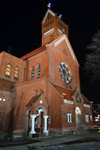 Red Catholic church in the center of Minsk at night — Stock Photo