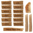 Retro calendar development concept for burned letters on board wood — Stock Photo