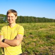 Stock Photo: Mstanding in field