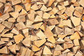 Stacked fire wood background — Stock Photo