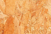 Wooden or chip board background — Photo