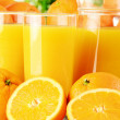 Glasses of orange juice and fruits - Stock Photo
