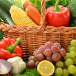 composition with vegetables and fruits in wicker basket isolated — Stock Photo #7604864