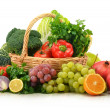 Composition with vegetables and fruits in wicker basket isolated — Stock Photo #7605047