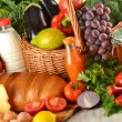 Groceries in wicker basket including vegetables and fruits — Stock Photo #7605662