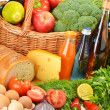 Groceries in wicker basket including vegetables and fruits — Stock Photo #7605701