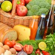 Groceries in wicker basket including vegetables and fruits — Stock Photo