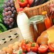 Groceries in wicker basket including vegetables and fruits — Stock Photo #7605776