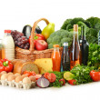 Groceries in wicker basket including vegetables and fruits — Stock Photo #7605844