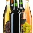 Stock Photo: Composition bottles of wine of different sort