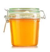 Jars of honey isolated on white — Stock Photo