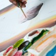 Asian hand painter painting water color picture — Stock Photo