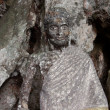 Ancient buddha statue in yala cave temple, thailand - Stock Photo