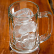 Ice in mug on table - Stock Photo