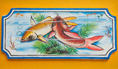 Chinese koi fish painting on wall in chinese temple — Stock Photo