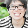 Stock Photo: Asian thai chinese smiled smart man with glasses
