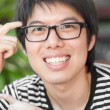 Stock Photo: Asian thai chinese smiled smart man with glasses thinking consul