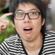 Asian thai chinese smiled smart man with glasses thinking consul — Stock Photo