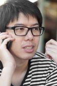 Asian thai chinese smiled smart man with glasses talking telepho — Stock Photo