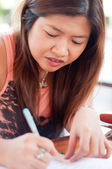 Asian thai attractive women writing — Stock Photo