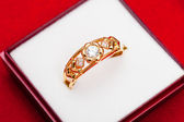 Gold ring with white zirconia enchased — Foto de Stock
