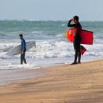 ������, ������: Bodyboader and surfer