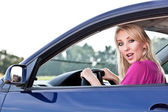 Beautiful blonde girl driver — Stock Photo